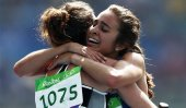 True Olympic spirit : 2 athletes help each other mid-race